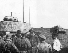 Commanders stand behind some Panzer III Ausf Ms at Kursk 1943.