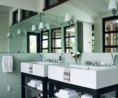 His & her sinks plus lots of natural light. And plenty of storage for towels. This is a must in my dream bathroom!