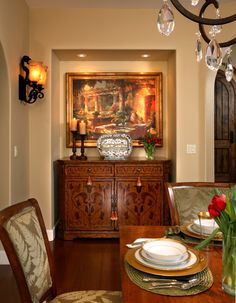 SUZANNE MYERS ELITE INTERIOR DESIGN: Dining room vignette contains a hand-painted Italian server with Italian-inspired painting above.