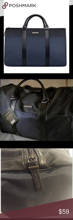 """MICHAEL KORS DUFFLE BAG Brand new Michael Kors weekender duffle bag. Features black interior lining with double handles. This navy and black duffle is great for women or men. Perfect for weekend travel or the gym. Great for men or women. Gift with purchase. Material polyester w/ Polyurethane trim. Approx size 18""""l x 12h x 9""""d. Strap drop 8"""". Michael Kors Bags Travel Bags"""