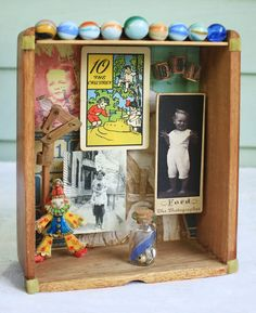 OOAK 3D assemblage with the theme of boys toys. This assemblage contains a vintage studio portrait of a very happy little boy, and a snapshot