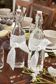 Lace around vintage water bottles - table setting