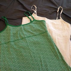 Camisole Bundle Bundle of camisoles. Green is NWOT Sonoma brand- S. Cream is SO brand-L (fits like a small) both have built in cami shelf bras and adjustable straps. Straps on cream top show signs of wear (as pictured)- otherwise in Excellent condition. Tops Tank Tops