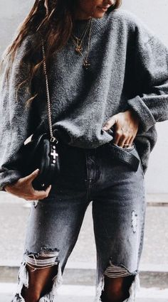 Oversized gray sweater over gray distressed jeans.