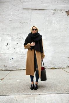 Camel coat and black oversize scarf