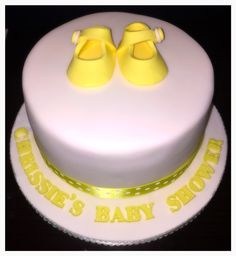 Baby shower cake with very cute handmade baby shoes on top