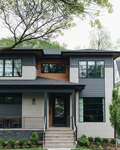 Cement Board Lap Siding Home exterior with Cement Board Lap Siding, black windows, black James Hardie plank siding and Cedar soffit. House Siding, House Paint Exterior, Exterior House Colors, Facade House, Exterior Cladding, Exterior Trim, Modern Exterior, Exterior Design, Black Trim Exterior House