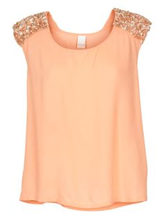 Adorable! Loose-fitting top with round neckline and Beads and sequins on the shoulders.