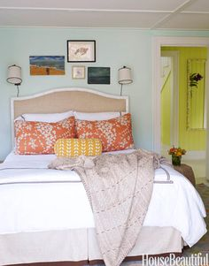 For this guest room, designer John Willey took a 1960s color combination — aqua and orange — and updated it. Walls are Benjamin Moore's Lido Green. Featured in the March 2009 issue.