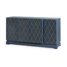 The Janak, large 4-door cabinet is a super-glamorous, high-style design that bridges Bauhaus principles and mid-century styling to create a craft intensive version of Hollywood Regency. The design features colored, textured grasscloth sheathing and a shaped top with two central doors that emerge to break the long surface with pretty dimension and matched, diamond patterned nail heads.   Details: Lacquered Grasscloth And Wood, Gold Finish Ring Pull