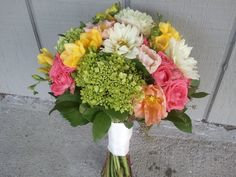 hydrangea, mini roses, freesia, daisy wedding bouquets. Done in purple and white