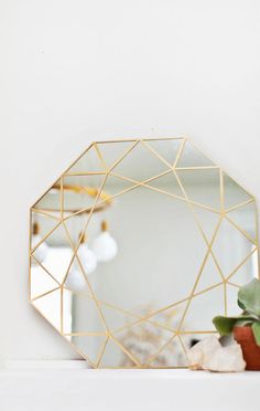 No matter the shape of your mirror, you can fake a faceted look in no time flat with a little gold contact paper and a trusty straight edge. #DIY