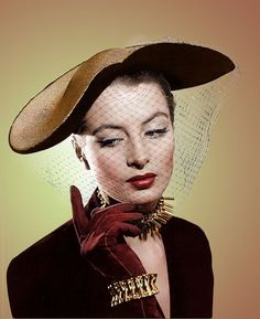 Model and actress Capucine sporting a gorgeous dark burgundy and gold ensemble. Description from pinterest.com. I searched for this on bing.com/images