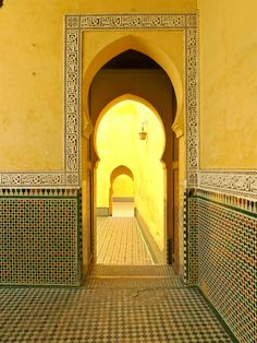 This photograph I shot in the Mausoleum of Moulay Ismail in Meknes / Morocco. It features the light - flooded doorway into the Prayer Hall.