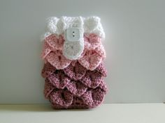 """Protect your cell phone with this pink crochet cell phone cozy done in crocodile stitch. The overlapping """"crocodile"""" scales make this cozy thicker to help pad your phone and protect it. There is a flap that buttons closed to hold your phone securely inside."""