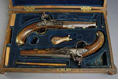 Gorgeous vintage dueling pistols in blue velvet lined box.just amazing.