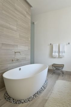 A possible different approach. Like the warm grey of the and the wood grain of the tile and the way it matches on floor and up the wall. Interesting treatment of the tub set on a ring of stones. Very beach and zen. Kind of like this. Too modern? Don't know...thoughts? KC, RC Read More: https://www.stylemepretty.com/living/2016/03/25/5-things-every-dream-house-needs/
