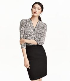V-neck blouse in woven fabric with concealed buttons at front, chest pockets, and 3/4-length sleeves with a button at cuffs.