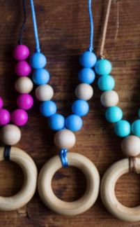 Babywearing accessories are designed with a breakaway clasp from ChompyChicChewlery.