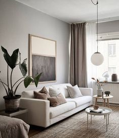 The styling of this Swedish apartment is simple, yet so striking. The minimal beige Ikea sofa, customised with a Bemz cover* is paired up wit a beige carpet, a beautiful art piece on the wall and a statement black armchair … Continue reading → Design Apartment, Minimal Apartment Decor, Scandinavian Apartment, Scandinavian Bedroom, Scandinavian Interior Design, Scandinavian Style, Elegant Living Room, Beige Living Rooms, Minimal Living Rooms