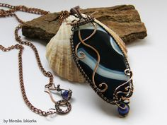 Wynda- wire wrapped necklace/pendant with bark blue/ navy blue and white agate. Oxidized/tinted, hammered and polished copper wire for ancient, old looking, vintage effect. Pendant size is about 7,8 x 3,2 cm. 100% handmade. Made by Monika Iskierka.