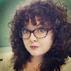 Naturally curly hair with bangs. (My hair)