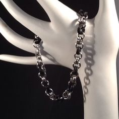 Stainless steal and black link bracelet Approximately 9 inches. Adjustable Jewelry Bracelets