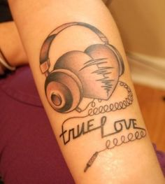 This is very similar to the tattoo on the inside of my left ankle except to curly cord and words.