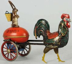 Tin Litho Lehmann Duo Rooster Wind-Up Toy. German. Working. Later version without gallery. Depicts rooster pulling rabbit on egg.