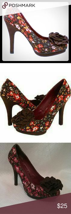 "Stunning Floral Platform Pump with Flower Accent The ""Salza"" platform pump from Madden Girl is a fabulous look for Spring through fall. The beautiful floral patterned fabric has highlights of orange, gold, green, white and tan on a rich chocolate brown background with a lovely flower accent at the toe. A 3.25""  stiletto heel and a .375"" platform makes for a very flattering look. These are preowned and in very good condition. There is some very slight scuffing on the heels as pictured. Madden…"