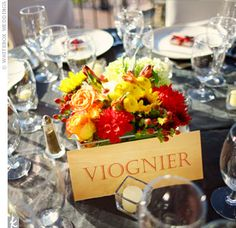 Arrangements of richly-toned blooms of orange, gold, and red continued the autumn theme against opulent champagne and chocolate covered linens.