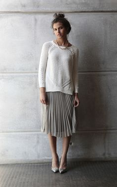 Thinking in a pleated skirt