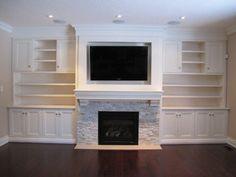 Door across built in, rock & TV on fireplace