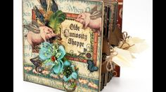 Walk through video of a Graphic 45 Square Tag Mini Album made with the newly re-released Deluxe Collector's Edition of Olde Curiosity Shoppe.