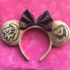Ears inspired by the Lion King! Made with furry fabric and painted details. No animals were hurt in the making of this product.