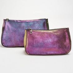 Tracey Tanner Slick Sparkle Cosmetics Pouch      An, iridescent, sparkling metallic finish adds edge to this zip-top cosmetics pouch. Easily transitioning from day to night - it stashes all of the essentials and doubles as a clutch. Handcrafted in Tracey Tanner's Brooklyn studio.