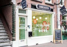 BURO NANA have designed the branding and interior design for Bubble&Stitch, a laundrette shop in Amsterdam with a new 24/7- open retail concept based on an app and a locker system.