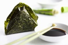 Onigiri (rice canape in a nori leaf filled with salmon, Japan) with soya sauce