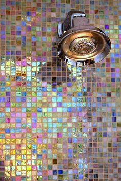 This colored tile shower would make anyone's morning a bit happier.