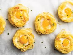 """I love these soft-cooked quail eggs nestled into crisp and creamy pasta gratin """"nests."""" The edges of the pasta get just a little caramelized and are easy to eat; you can make them in advance and warm them up before adding the eggs. Be sure to serve the nests quickly after the eggs have cooked."""