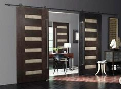 Trustile Tru & Modern.  Walnut doors with leather inserts, hung on barn door hardware.