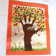 Hand print and finger painting craft of a tree in autumn
