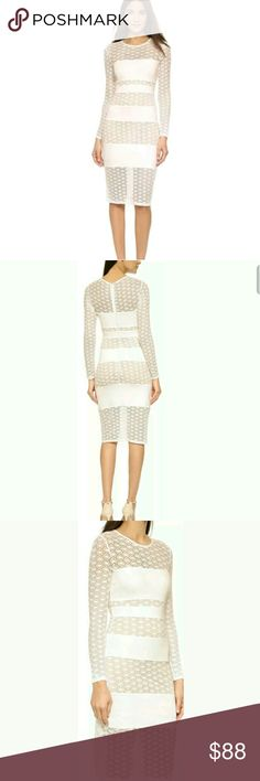 """ALI&JAY PONTE LACE PANELED GEO SHEATH DRESS A TINY MARK ON THE FRONT,BARELY VISIBLE. WITH TAG.ALI & JAY PONTE LACE PANELED GEO SHEATH DRESS WHITE/NUDE .SIZE M.THIS LONG SLEEVED GEO LACE SHEATH DRESS FEATURES STRATEGICALLY PLACED SOLID PANELS OF PONTE KNIT AND A NUDE ILLUSION LINING THAT KEEPS YOU COVERED. MIX OF CROCHET AND PONTE JERSEY. HIDDEN BACK ZIP CLOSURE. TAN-COLORED JERSEY LINING. LENGTH APPROX 40"""",ARMPIT TO ARMPIT APPROX 15.5"""",SLEEVE LENGTH 23"""" ,WAIST 13, HIPS  16""""ALL MEASUREMENTS…"""