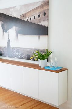 Modern dining room with large art and floating sideboard. | Remodelaholic Buffet Bas Ikea, Knoxhult Ikea, Wood Shoe Storage, Diy Storage Projects, Modern Sideboard, Sideboard Buffet, Ikea Sideboard Hack, Ikea Tv Console, Narrow Sideboard