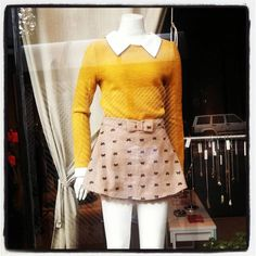 Bow skirt, yellow sweater with trimmed collar