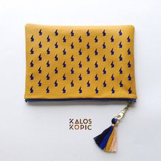 We love #patterns and #colours @kaloskopic this #bolts bag is part of our #lasercut range. It comes in 3 different sizes all with soft fabric lining. #leathergoods #printdesign by kaloskopic
