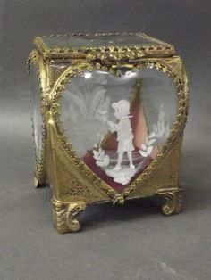 A C19th gilt, brass and glass casket standing on :