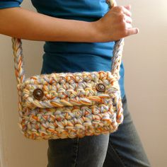 Check out this crochet plush clutch bag that Genuine Mudpie made.  She uses a Q hook and several strands of yarn but you could also use a super bulk yarn like Heartland Thick & Quick.