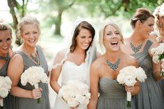Love the grey dresses, perhaps each with a different brightly colored bouquet?