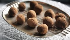 Super-tasty, impressive, messy but easy treats. Omit the rum for the teetotallers among you or ramp up the rum to three tablespoons for a good rum flavour. These truffles freeze very well.